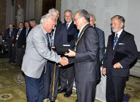 George Zarzycki being congratulated by President Orhan Altan on receiving an ISPRS Fellowship