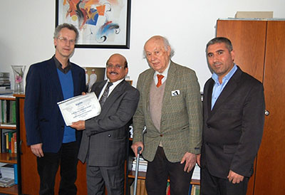 from left to right: Christian Heipke, President ISPRS, Muhamad Alrajhi, ISPRS Regional Coordinator for the Arab States, Gottfried Konency, ISPRS Honorary Member and President 1984-1988, Abdalla Alobeid, MOMRA, during a meeting in Hannover, Germany, on Feb. 24, 2017.